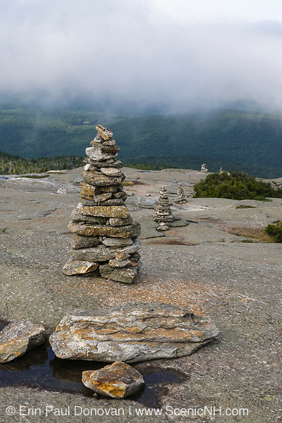 Rock cairns along the West Ridge Trail near the summit of Mount Cardigan Mountain in Orange, New Hampshire. Fire burned over this summit in 1855, and is reason for bald summit.