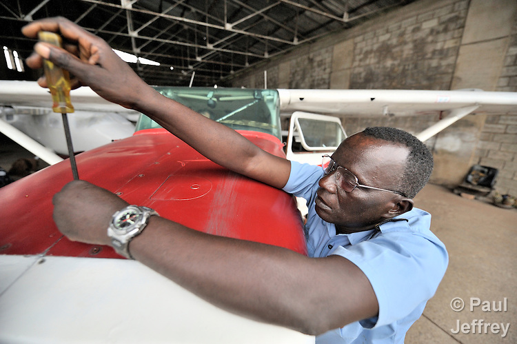 Jacques Umembudi Akasa, a pilot, working in the hangar of Wings of Caring Aviation in Kananga, Congo. The program is sponsored by the United Methodist Church.