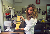 - Italian food , typical kitchen of the Emilia region, restaurant &quot;Da Ivan&quot; in Roccabianca (Parma), Barbara Aimi, wife of the owner, prepares pasta for tortelli (stuffed pasta).<br /> <br /> - Cibo italiano, cucina tipica della regione Emilia, ristorante &quot;Da Ivan&quot; di Roccabianca (Parma), Barbara Aimi, moglie del titolare prepara la pasta per i tortelli
