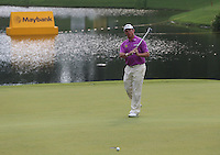 Lee Westwood (ENG) attempting to seal the win on the 15th narrowly misses during the Final Round of the 2014 Maybank Malaysian Open at the Kuala Lumpur Golf & Country Club, Kuala Lumpur, Malaysia. Picture:  David Lloyd / www.golffile.ie