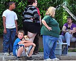 Jaycob Roberts, 11, with his dog Toby, look on as firefighters work, as he and other residents, some with their pets, were force to flee from a smoke condition in their building, Monday, July 13, 2015, in the Rockville section of Vernon. The incident happened just before 5pm at a five family apartment building at 105 Prospect Street after an unknown smoke condition developed in the building. After about an hour of searching with thermal imaging camera, Town of Vernon Fire Department determined the smoke came from a  lamp fixture and residents were able to return to their apartments. (Jim Michaud / Journal Inquirer)