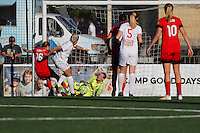 Rochester, NY - Friday June 17, 2016: Western New York Flash goalkeeper Britt Eckerstrom (28), Portland Thorns FC defender Emily Sonnett (16), Western New York Flash defender Abigail Dahlkemper (13) after a regular season National Women's Soccer League (NWSL) match between the Western New York Flash and the Portland Thorns FC at Rochester Rhinos Stadium.