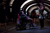 People walk through the Park Avenue Tunnel during and art exhibition for pedestrians by the Mexican Artist Rafael Lozano-Hemmer in New York August 03, 2013 by Kena Betancur / VIEWpress