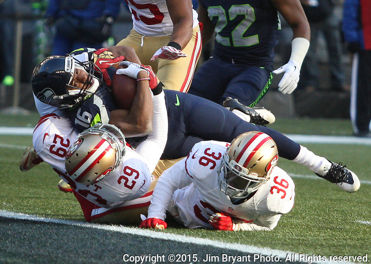 Seattle Seahawks wide receiver Tyler Lockett  (16) fights his way into the end zone to score a touchdown against San Francisco 49ers defensive backs Donate Johnson (36), Eric Reid (35) and Jaquiski Tartt (29)  at CenturyLink Field in Seattle, Washington on November 22, 2015.  The Seahawks beat the 49ers 29-13.   ©2015. Jim Bryant Photo. All RIghts Reserved.