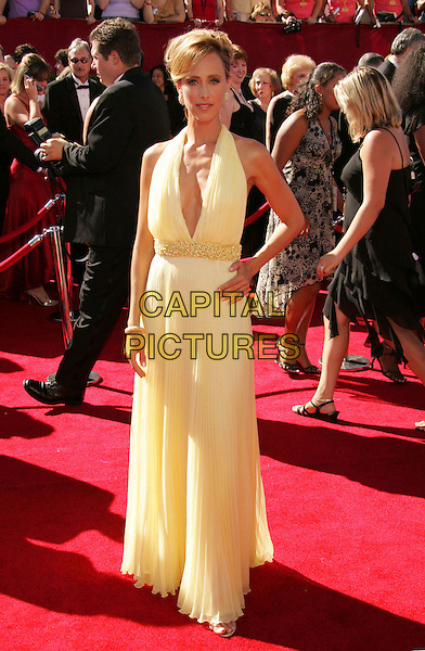 KIM RAVER.58th Annual Primetime Emmy Awards held at the Shrine Auditorium, Los Angeles, California, USA..August 27th, 2006.Ref: ADM/RE.full length yellow halterneck hand on hip dress.www.capitalpictures.com.sales@capitalpictures.com.©Russ Elliot/AdMedia/Capital Pictures.