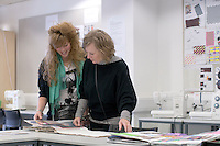 Mother & daughter looking through display work in the Fashion Dept., Open Day at Kingston College when prospective students and their parents look around.