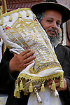 Israel, Bnei Brak. Succot holiday at the Premishlan congregation. Hasid with the Torah scrolls<br />