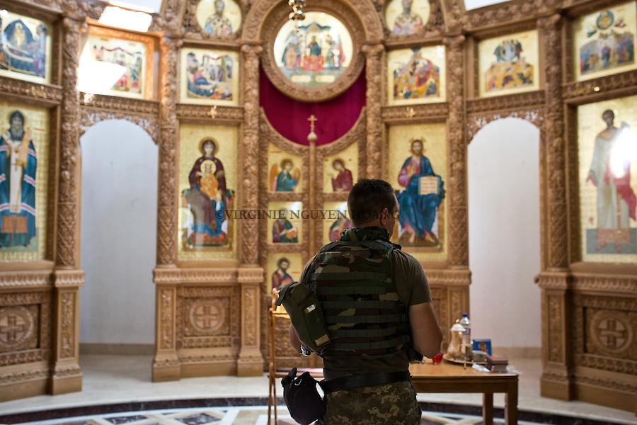 UKRAINE, Pisky: Constantine doing a prayer inside the Orthodox Church of Pisky.<br /> <br /> UKRAINE, Pisky: Constantine prie &agrave; l'int&eacute;rieur de l'Eglise orthodoxe de Pisky.