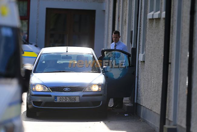 Nicola Kavanagh, being taken from Drogheda Garda Station to Trim District Court.<br /> <br /> Garda: female charged re House fire Drogheda Co. Louth 16th August 2014<br /> Gardai in Drogheda investigating a suspicious fire at a house in Drogheda Co. Louth on 16th August 2014 have charged a 26 year old female in connection with the incident. She was charged this evening the 18th August and she will appear before Trim District Ct, Co Meath.<br /> Picture: Fran Caffrey www.newsfile.ie
