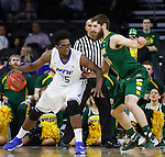 SIOUX FALLS, SD - MARCH 7:  Brent Calhoun #45 of Fort Wayne dribbles past Chris Kading #34 of North Dakota State in the 2016 Summit League Tournament.  (Photo by Dick Carlson/Inertia)