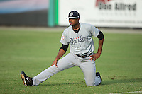 Pulaski Yankees starting pitcher Jhon Morban (56) stretches in the outfield prior to the game against the Burlington Royals at Burlington Athletic Park on August 6, 2015 in Burlington, North Carolina.  The Royals defeated the Yankees 1-0. (Brian Westerholt/Four Seam Images)