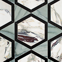 Hugo, a hand-cut stone mosaic, shown in polished Kay's Green, Nero Marquina, and Plumeria.