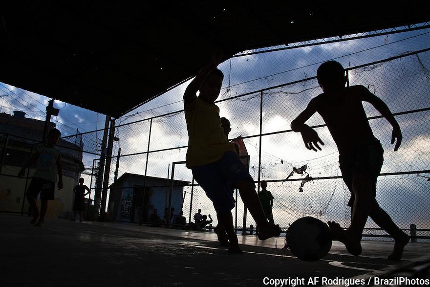 Children play soccer at Morro da Providencia, a favela in Rio de Janeiro downtown.