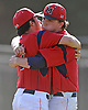 MacArthur pitcher No. 8 Jack Wall, right, gets a congratulatory hug from No. 7 Justin Norcini after their team's 7-4 win over Oceanside in Game 1 of the Nassau County varsity baseball Class AA final against Oceanside at Farmingdale State College on Saturday, May 30, 2015.<br /> <br /> James Escher