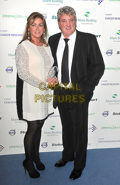 Guest & Steve Bruce.London - Emeralds and Ivy Ball held at Supernova, London, England, UK,  December 3rd 2011..full length  white black tights dress silver suit tie sparkly sleeves .CAP/ROS.©Steve Ross/Capital Pictures