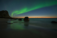 Twilight northern lights over Myrland beach, Flakstadøy, Lofoten Islands, Norway