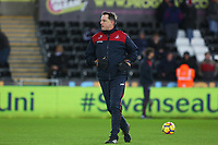 Swansea City goalkeeper coach Tony Roberts prior to kick off of the Premier League match between Swansea City and Manchester City at the Liberty Stadium, Swansea, Wales, UK. 13 December 2017