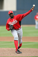 Dontrelle Willis #50 of the Cincinnati Reds pitches in a spring training game against the Milwaukee Brewers at Maryvale Stadium on March 20, 2011  in Phoenix, Arizona. .Photo by:  Bill Mitchell/Four Seam Images.