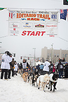 Josh Cadzow and team leave the ceremonial start line at 4th Avenue and D street in downtown Anchorage during the 2013 Iditarod race. Photo by Jim R. Kohl/IditarodPhotos.com