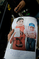 Hosman Araya´s wife Amgelica Ancolpie (21) picture. She  printed, write a message and now is going to her husban down the mine. This is the first pictures taken by a local photogrpaher that has been sent down to the mine where the 33 are located. Relatives and friends wait outside the mine where 33 miners are trapped in a collapsed tunnel in North Chile since August 5th.