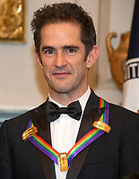 Andy Blankenbuehler, one of the special honorees for Groundbreaking Work on Hamilton, as he poses with the recipients of the 41st Annual Kennedy Center Honors pose for a group photo following a dinner hosted by United States Deputy Secretary of State John J. Sullivan in their honor at the US Department of State in Washington, D.C. on Saturday, December 1, 2018.  The 2018 honorees are: singer and actress Cher; composer and pianist Philip Glass; Country music entertainer Reba McEntire; and jazz saxophonist and composer Wayne Shorter. This year, the co-creators of Hamilton,? writer and actor Lin-Manuel Miranda; director Thomas Kail; choreographer Andy Blankenbuehler; and music director Alex Lacamoire will receive a unique Kennedy Center Honors as trailblazing creators of a transformative work that defies category.<br /> CAP/MPI/RS<br /> &copy;RS/MPI/Capital Pictures