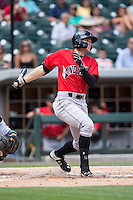 Austin Meadows (19) of the Indianapolis Indians watches his first Triple A home run leave the ballpark against the Charlotte Knights at BB&T BallPark on June 19, 2016 in Charlotte, North Carolina.  The Indians defeated the Knights 6-3.  (Brian Westerholt/Four Seam Images)