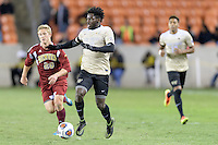 Houston, TX - Friday December 9, 2016: Ema Twumasi (22) of the Wake Forest Demon Deacons looks to pass the ball against the Denver Pioneers at the NCAA Men's Soccer Semifinals at BBVA Compass Stadium in Houston Texas.