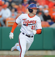 Designated hitter Shane Kennedy (11) of the Clemson Tigers in a game against the William & Mary Tribe on Opening Day, Friday, February 15, 2013, at Doug Kingsmore Stadium in Clemson, South Carolina. Clemson won, 2-0. (Tom Priddy/Four Seam Images)
