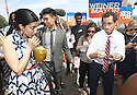 Anthony Weiner right, along with wife Huma Abedin left attend the Jamaica Jerk Festival at Roy Wilkins Park in Queens on Sunday, July 21, 2013. (AP Photo/ Donald Traill)