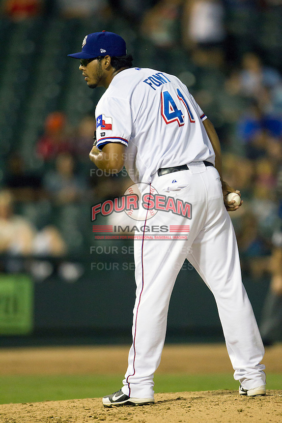 Round Rock Express pitcher Wilmer Font (41) looks to his catcher for the sign during the Pacific Coast League baseball game against the New Orleans Zephyrs on June 30, 2013 at the Dell Diamond in Round Rock, Texas. Round Rock defeated New Orleans 5-1. (Andrew Woolley/Four Seam Images)