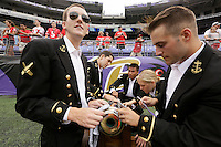 "Cadets in Navy's 5th Company called ""Cannoneers,"" clean the cannon, which is fired for touchdowns, prior to Saturday's NCAA Division I football game between Ohio State Buckeyes and Navy Midshipmen at M&T Bank Stadium in Baltimore on August 30, 2014. Left to right: Sam Crockett of South Dakota, Tim Fisher of Maryland, Vincent Chu of California, Margo Darragh of Pennsylvania, and Daniel Alcantor of California. (Dispatch Photo by Barbara J. Perenic)"