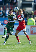 26 March 2011:Portland Timbers forward Kenny Cooper #33 and Toronto FC defender Adrian Cann #12 in action during an MLS game between the Portland Timbers and the Toronto FC at BMO Field in Toronto, Ontario Canada....