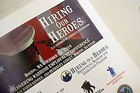 Hiring Our Heroes and Wounded Warrior Project materials lay on the registration table at the Recovering Warrior Employment Conference at the Back Bay Event Center in Boston, Massachusetts, USA.The employment conference was organized by Hiring Our Heroes and Wounded Warrior Project. Hiring Our Heroes is an initiative of the US Chamber of Commerce Foundation. Approximately 40 veterans registered for the event, during which they had interviews with a number of different regional and national employers, including GE, Bank of America, Uber, and others.