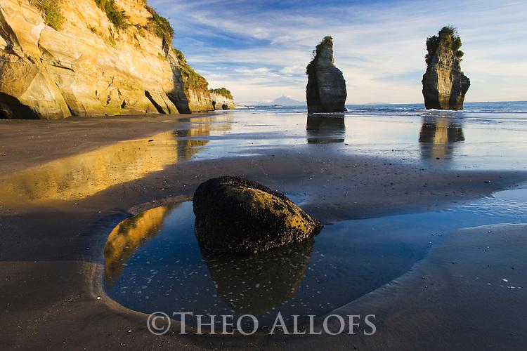 Cliffs and sea stacks at  North Taranaki Bight; sunset; North Island, New Zealand