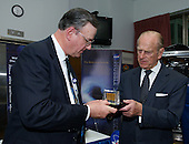 """Preston Burch, left,  Hubble Spece Telescope Program Manager presents Prince Philip with three solar cells returned from space during HST servicing mission -1. Photo Credit: """"NASA/Chris Gunn"""""""