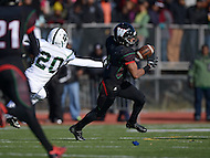 November 28, 2013  (Washington, DC) #1 D'Andre Payne of the H.D. Woodson Warriors evades #20 William Milligan (S) of the Woodrow Wilson Tigers in the 2013 DCIAA varsity football championship game November 28, 2013.  (Photo by Don Baxter/Media Images International)