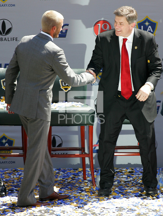 David Beckham shakes hands with his new boss Owner of the LA Galaxy Timothy Leiweke at his LA Galaxy press conference, along with Head Coach Frank Yallop at the Home Depot Center in Carson, California, Friday, July 13, 2007.