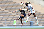 15 September 2013: North Carolina's Satara Murray (right) heads the ball over Notre Dame's Crystal Thomas (22). The University of North Carolina Tar Heels hosted the University of Notre Dame Fighting Irish at Fetzer Field in Chapel Hill, NC in a 2013 NCAA Division I Women's Soccer match. Notre Dame won the game 1-0.