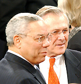 Washington, DC - January 28, 2003 -- United States Secretary of State Colin Powell, left, and United States Secretary of Defense Donald Rumsfeld, right, await the arrival of  United States President George W. Bush to deliver his State of the Union Address to a Joint Session of the United States Congress.<br /> Credit: Ron Sachs / CNP