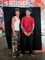 Jose Lopez Navarro (red shirt) and Andrez Serna Sandoval, 21 and 18 years old. Portraits of Adolescents San Cosme skate park, in Mexico City. Releases #15 and 16