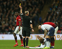 Paul Pogba of Manchester United  is booked after he catches Dele Alli of Tottenham Hotspur with a late tackle during Tottenham Hotspur vs Manchester United, Premier League Football at Wembley Stadium on 13th January 2019