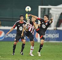 John Thorrington (8) of D.C. United goes against Miguel Sabah (9) of C.D. Guadalajara. C.D.Guadalajara tied D.C. United 1-1 during and international friendly, at RFK Stadium, Friday July 12, 2013.