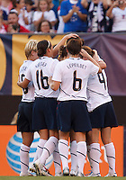 22 MAY 2010:  USA's Lori Lindsey #5, Ali Krieger, Amy LePeilbet  and Heather O'Reilly  celebrate a second half goal during the International Friendly soccer match between Germany WNT vs USA WNT at Cleveland Browns Stadium in Cleveland, Ohio. USA defeated Germany 4-0 on May 22, 2010.