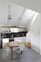 A compact open plan kitchen/dining area adjoins the living room on the ground floor
