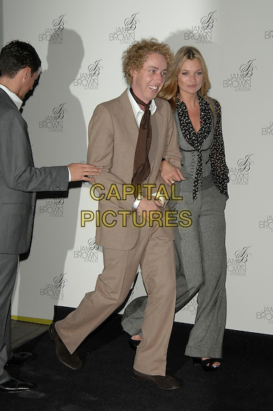 JAMES BROWN (hairstylist) & KATE MOSS.Kate Moss & James Brown attend launch of their new haircare range at Boots flagship store, Oxford Street, London, England..October 10th, 2007 .full length beige brown suit  black grey gray stars pattern print ruffles collar waistcoat flared trousers arms linked .Ref: CAP/PL.©Phil Loftus/Capital Pictures.