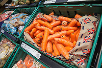 British carrots on dispaly for sale in a supermarket