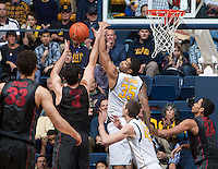Richard Solomon of California knocks the ball away during the game against Stanford at Haas Pavilion in Berkeley, California on February 5th, 2014.  Stanford defeated California, 80-69.