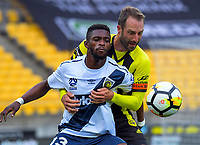 CCM's Kwabena Appiah-Kubi holds off Wellington's Andrew Durante during the A-League football match between Wellington Phoenix and Central Coast Mariners at Westpac Stadium in Wellington, New Zealand on Saturday, 25 November 2017. Photo: Dave Lintott / lintottphoto.co.nz