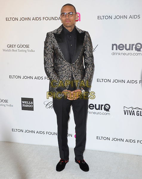 Chris Brown.The 21st Annual Elton John AIDS Foundation Academy Awards Viewing Party held at The City of West Hollywood Park in West Hollywood, California, USA..February 24th, 2013.oscars full length grey gray black shirt beige leopard print suit jacket glasses trousers.CAP/DVS.©DVS/Capital Pictures.