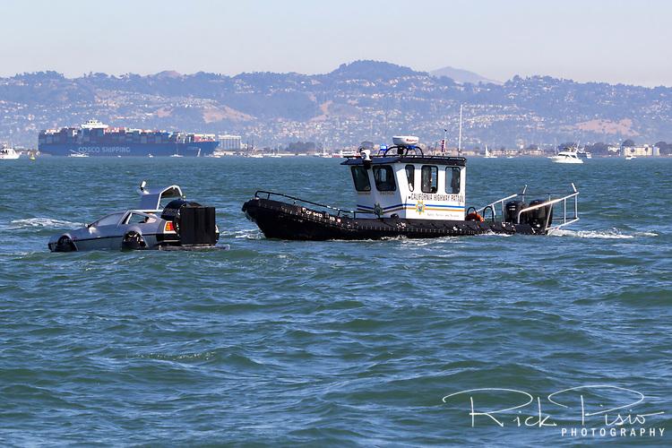 California Highway Patrol pulls over a Delorean on San Francisco Bay.
